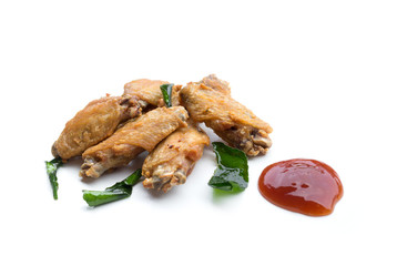 Fried chicken wings and ketchup isolated on white background