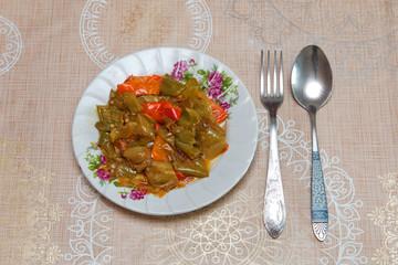Baked eggplant stuffed dish on the table, spoon and fork / Azerbaijani dish