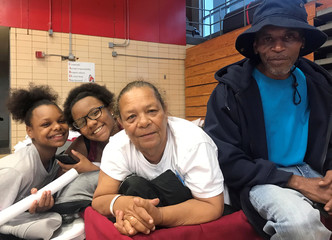 Duplessis of Port Sulfur, age 66,  sits with family members at the hurricane shelter set up in the Belle Chasse High School gym