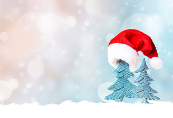 Christmas tree in Santa hat and Christmas decoration background
