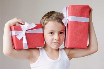 boy with two gifts show muscle