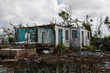 Homes sit in ruins at Codrington on the island of Barbuda just after a month after Hurricane Irma struck the Caribbean islands of Antigua and Barbuda