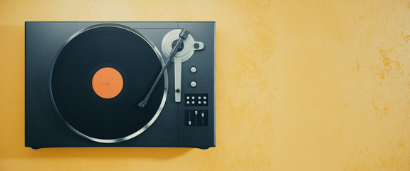 Vinyl record player on orange background