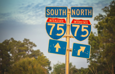 Directional signs along US Interstate I-75 in Florida. Sunset light
