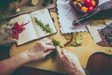 Old woman hands cutting herbs