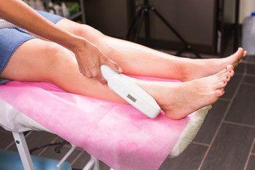 Laser epilation. Hair removal procedure. Cosmetology and SPA concept.