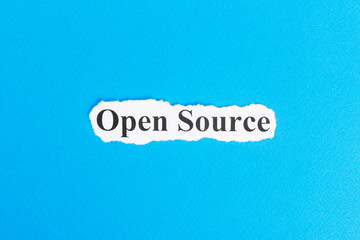 Open source text on paper. Word Open source on torn paper. Concept Image