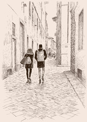 The young townspeople walking in the old town