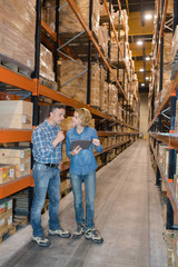 male and female warehouse workers in warehouse
