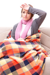 Teenager suffering from cold sitting on coach