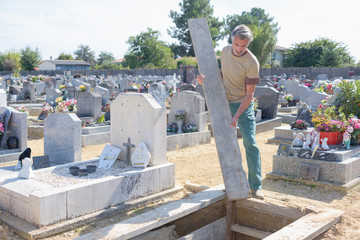 man working in cemetary