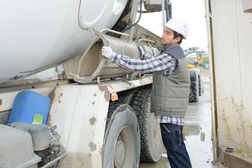 Man adjusting cement lorry