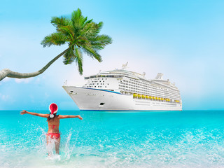 Wall Mural - Christmas cruise travel vacation woman swimming at Caribbean beach with ship and palm tree in background. Tropical destination holiday concept tourist on Xmas holidays.