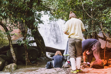 Foreigner  tourists  at Khao Yai  national park  with beautiful waterfall.many people looking at  a waterfall in the wild with happiness