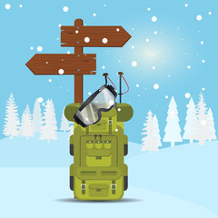 Winter background with skier backpack, goggles and wooden arrows.