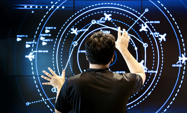 man control air traffic on touch screen in digital mornitor