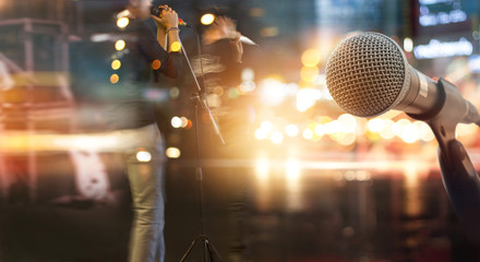 Abstract microphone and musician on stage for background, soft and blur concept