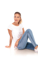 blonde woman in jeans and tshirt sits on the floor