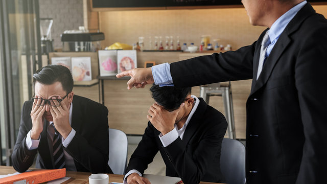 young businessman blamed and stressed by boss