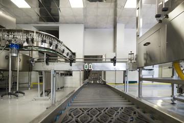 Steel conveyor for transportation of glass bottles.