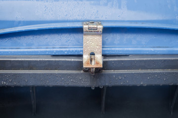 Blue dustbin with padlock