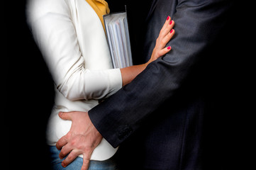 Man touching woman's butt - sexual harassment in office