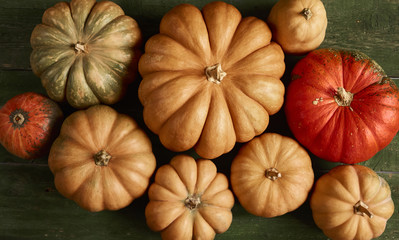 A lot of pumpkin on rustic background. Top view