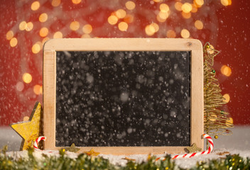 Christmas Blackboard with Snow and red Bokeh Lights Background, warm and cozy with copy space