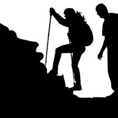 Vector silhouette of couple a climbing on a rock on a white background.