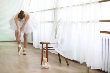 Pretty girl ballet dancer practicing