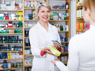 Seller helping customer to choose care products
