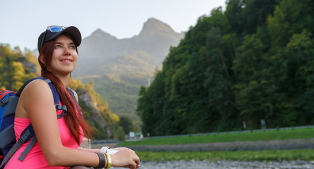 Image of tourist woman with backpack backdrop of mountains