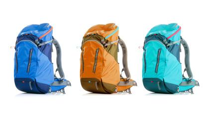Image of three backpacks on empty background