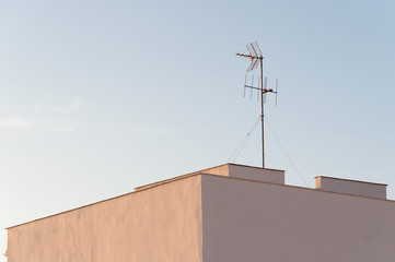 antenna on a roof at dawn
