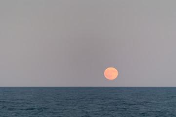 full moon at the mediterranean sea