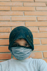 terrorist boy with his face covered