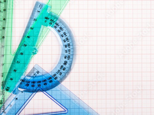 drawing tools on blue graph paper with copy space stock photo and