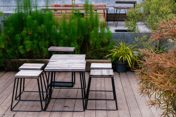 set of wooden table and chair decorated in garden