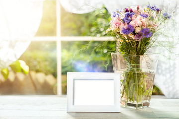 Empty frame mockup with flowers