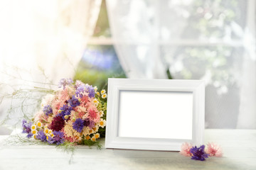 White frame mockup and bouquet
