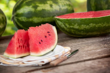 Big watermelon slices on wooden table
