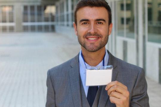 Speaker showing his id badge