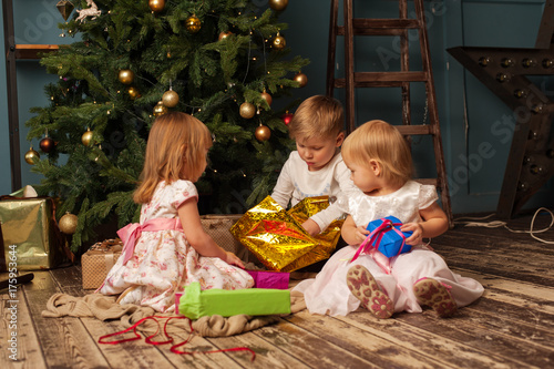 group of children with christmas gifts at home