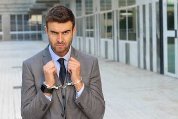Handcuffed businessman with copy space