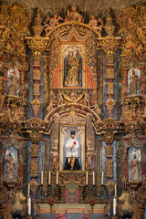 Closeup of interior wall behind the altar of the San Xavier del Bac mission church in Tucson, Arizona