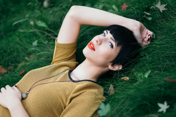 Dreamy Portrait of a Young Woman Lying in the Grass