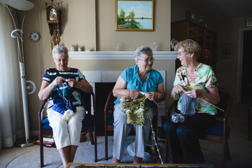 Group of senior women knitting together