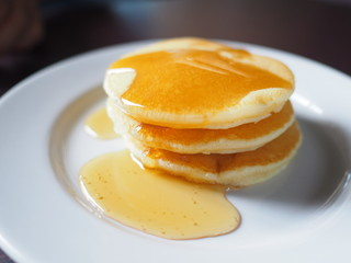 Stack of pancakes dessert with maple syrup.