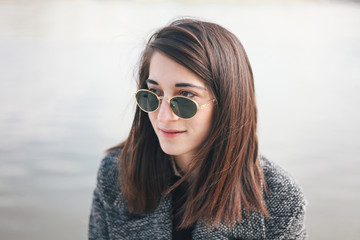 Portrait of a beautiful young woman with sunglasses outdoors