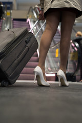 Business women is walking at the station.